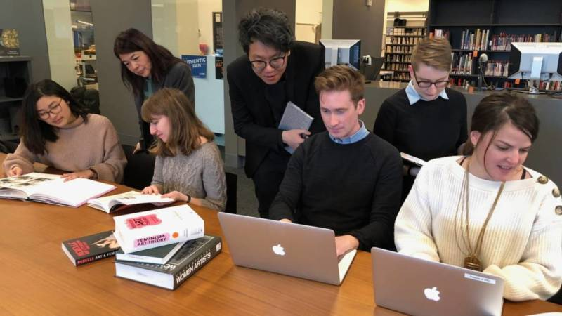Editors hard at work at the first annual Art+Feminism edit-a-thon hosted by Stanford's Bowes Art and Architecture Library in 2017.