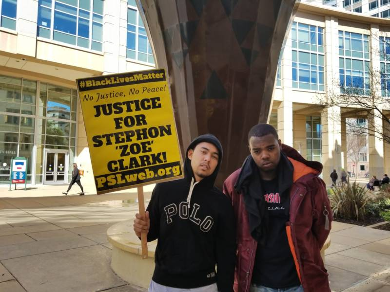 Anthony Cain and Clinton Primm, friends of Stephon Clark, rally outside Sacramento City Hall to protest his death.