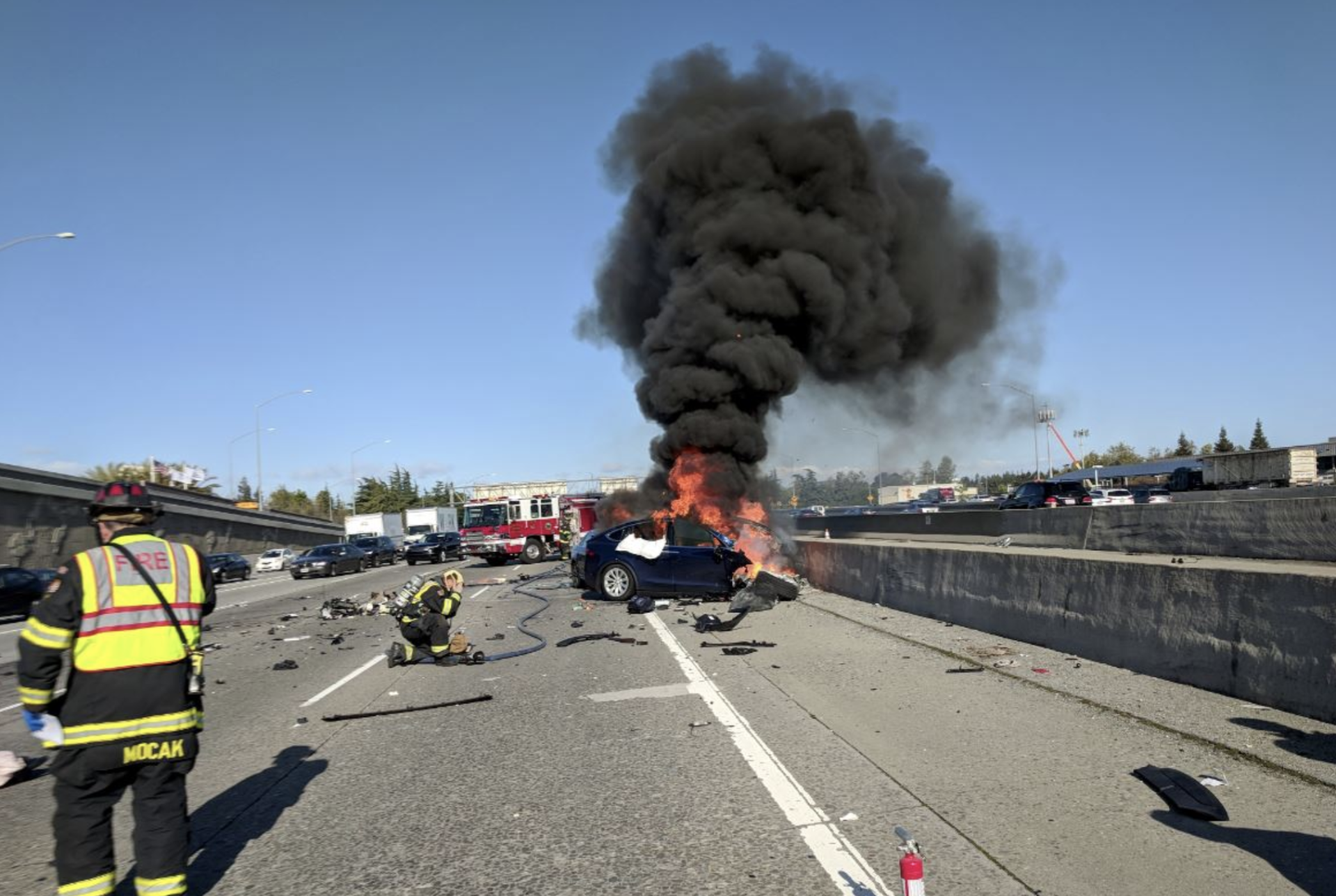 A Tesla Model X burns on U.S. 101 after crashing Friday morning in Mountain View.