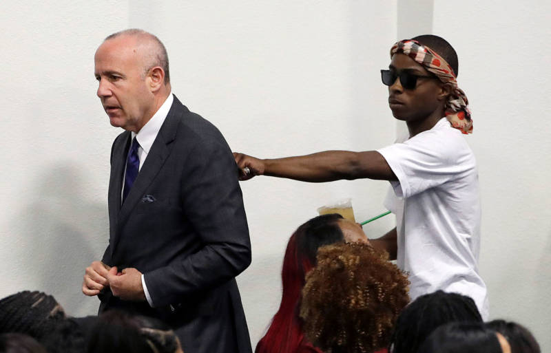 Sacramento Mayor Darrell Steinberg walks with Stevante Clark during the funeral services for police shooting victim Stephon Clark.