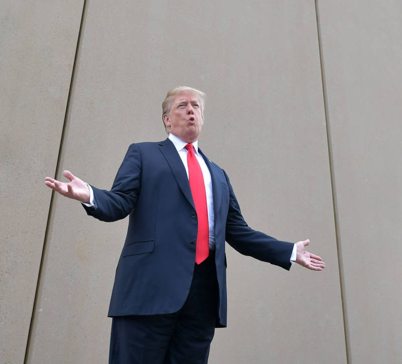 President Donald Trump speaks as he stands in front of a border wall prototype in San Diego on March 13, 2018.