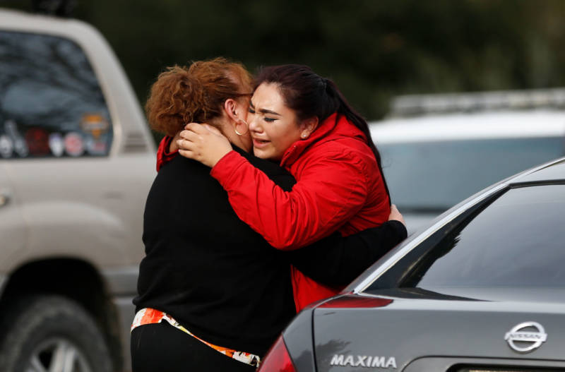 Vanessa Flores (R) embraces another woman after she leaves the locked down Veterans Home of California during an active shooter turned hostage situation on March 9, 2018 in Yountville.