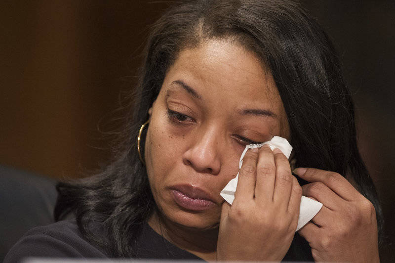 Kubiiki P. wipes tears as she testifies at a 2017 Senate hearing, speaking about her young daughter being sold for sex on Backpage.com.