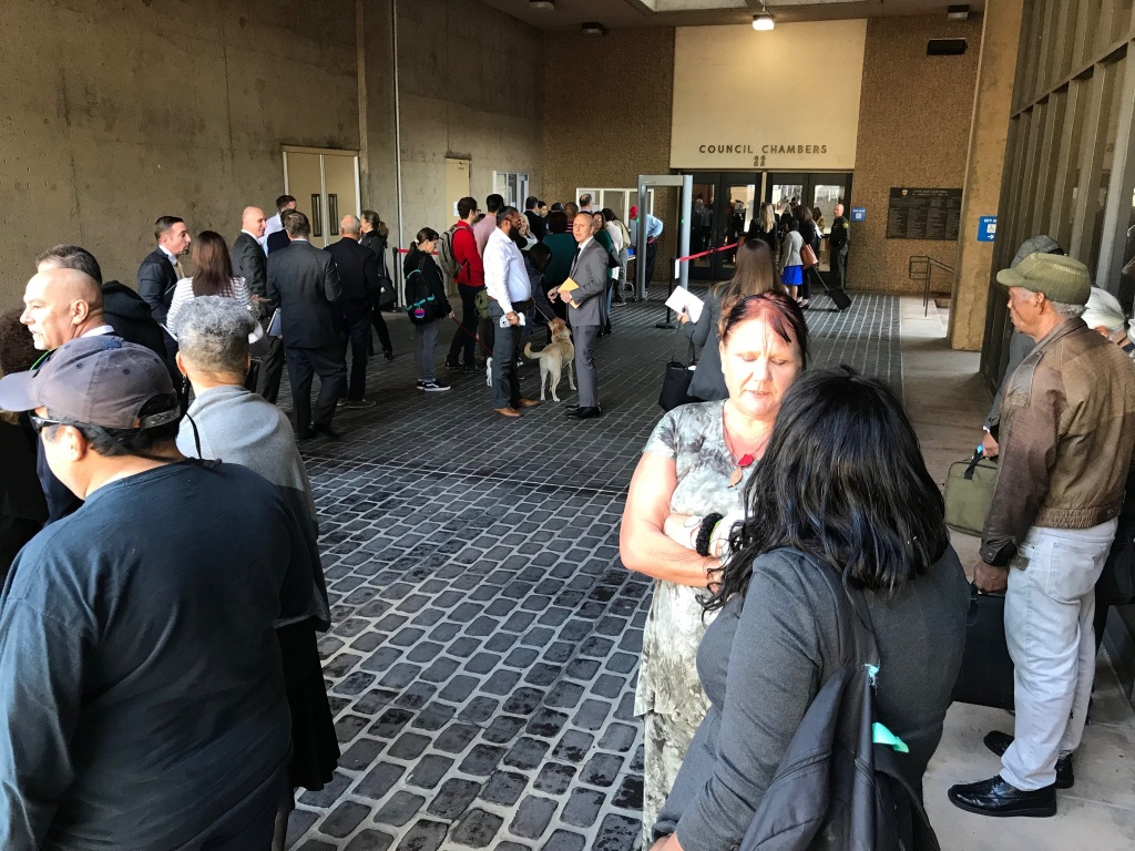 People line up on Saturday, March 17, 2017 to get into an Orange County courtroom for a hearing, presided over by Judge David O. Carter, addressing what to do about 700 homeless people who were recently removed from their encampments along the Santa Ana riverbed.
