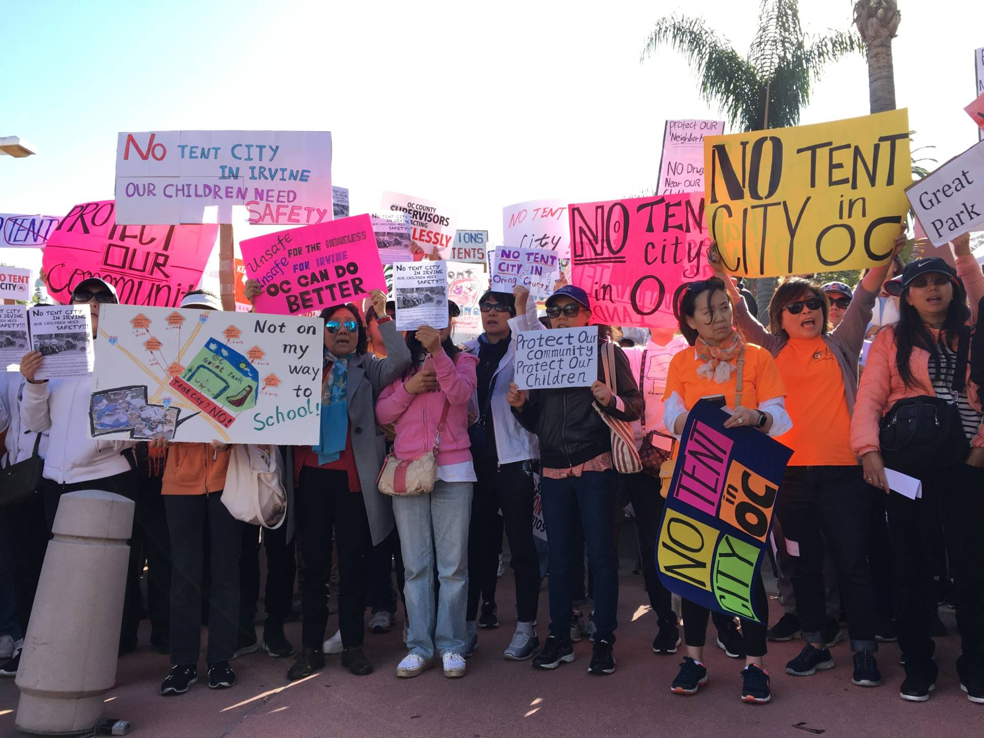 Protesters arrived in chartered buses to fight a plan by Orange County to relocate homeless people from Santa Ana to new temporary shelters in more affluent coastal cities. Linda Wang/NPR