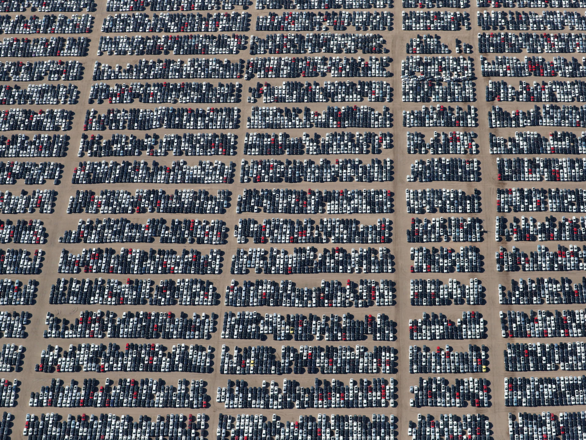 Reacquired Volkswagen and Audi diesel cars sit in a desert graveyard near Victorville, Calif., on Wednesday. Volkswagen AG has paid more than $7.4 billion to buy back about 350,000 vehicles, the automaker said in a recent court filing. Lucy Nicholson/Reuters