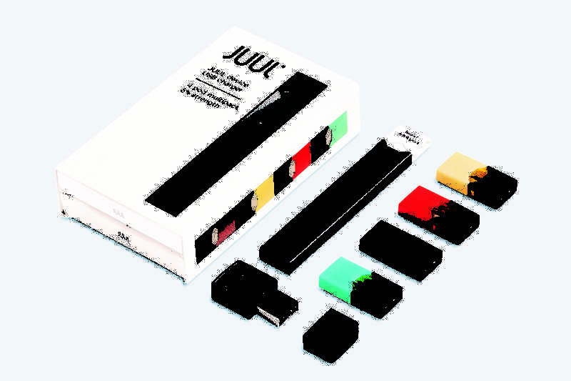 Colorful nicotine-filled pods, pictured on the right, are inserted into the Juul e-cigarette, which educators say looks deceptively like a flash drive, making it harder to identify.