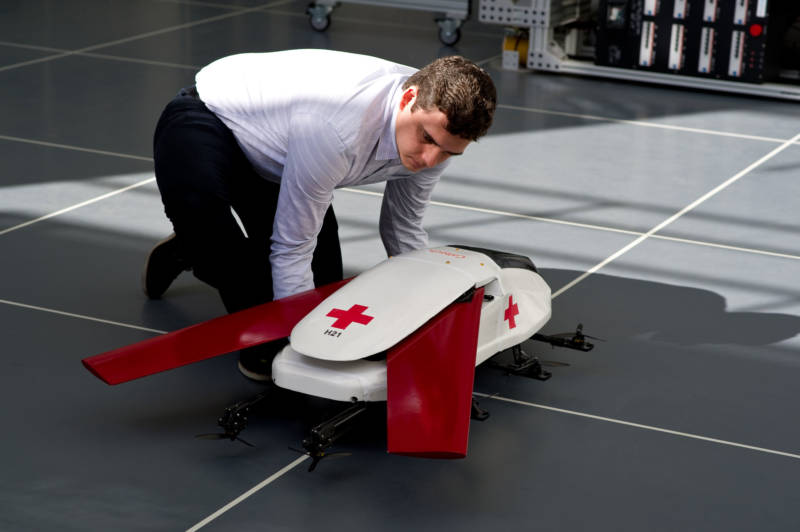 Graduate researcher Chris Dougherty prepares a scale model air ambulance robot for a demonstration flight.