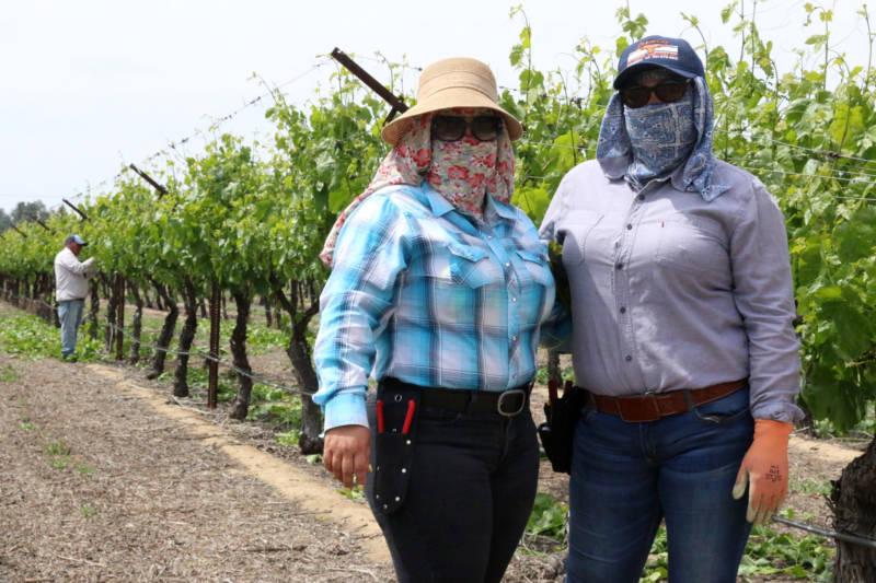 Farm labor contractor Jasmine Quintanilla (L) and forewoman Rosa Lopez worked with farmworkers Santos Hilario Garcia and Marcelina Garcia Perfecto for several years in Delano.