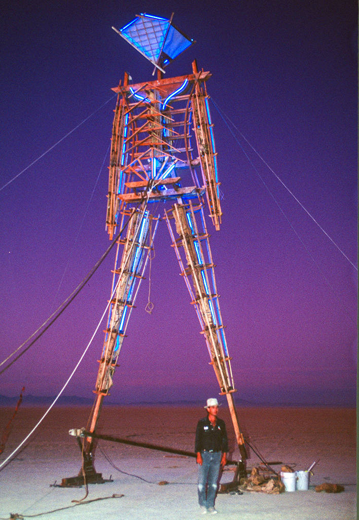 """Larry Harvey in front of """"Burning Man"""" in 1991."""