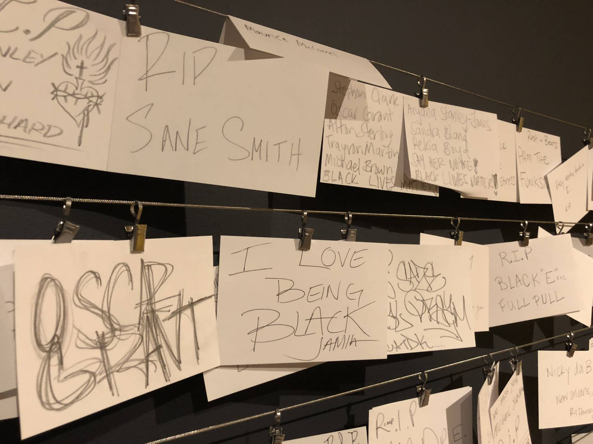 People can write their own memorials and hang them on the wall next to the street memorial.