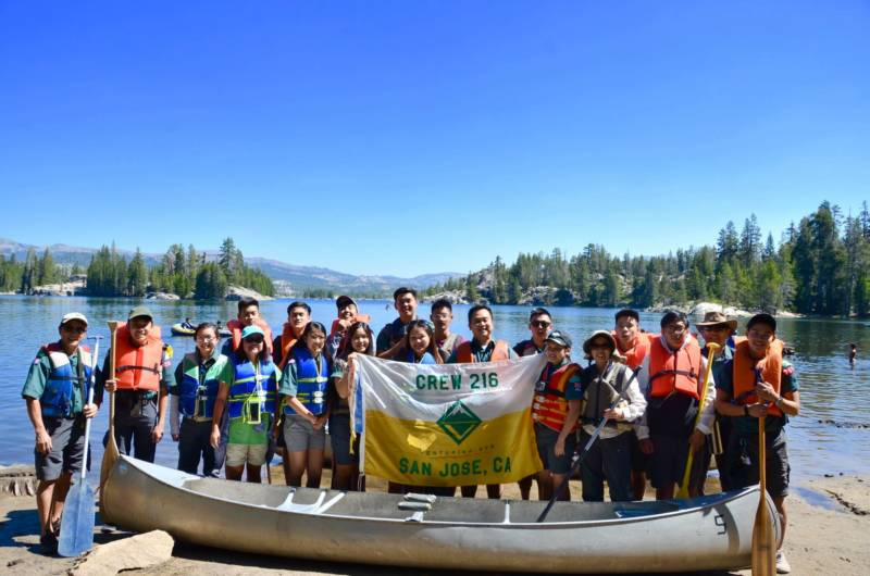 Lucas Tran (back row in sunglasses) and Scout Crew 216 canoe camping at Utica Reservoir in 2017.