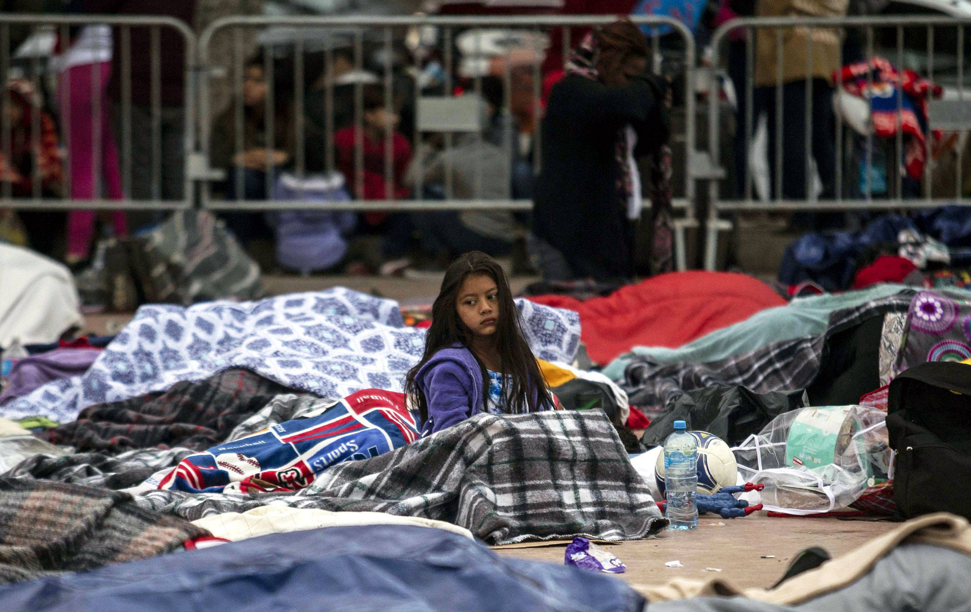 Central American migrants traveling in the 'Migrant Via Crucis' caravan sleep outside 'El Chaparral' port of entry to the U.S. while waiting to be received by U.S. authorities, in Tijuana, Mexico on April 30, 2018. GUILLERMO ARIAS/AFP/Getty Images