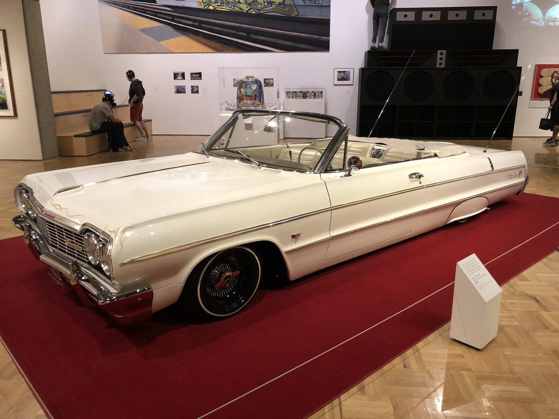 """A 1964 Chevy Impala Lowrider at the """"Respece: Hip-Hop Style & Wisdom"""" exhibit at the Oakland Museum of California exhibit. Car culture is a big part of hip-hop history and culture."""