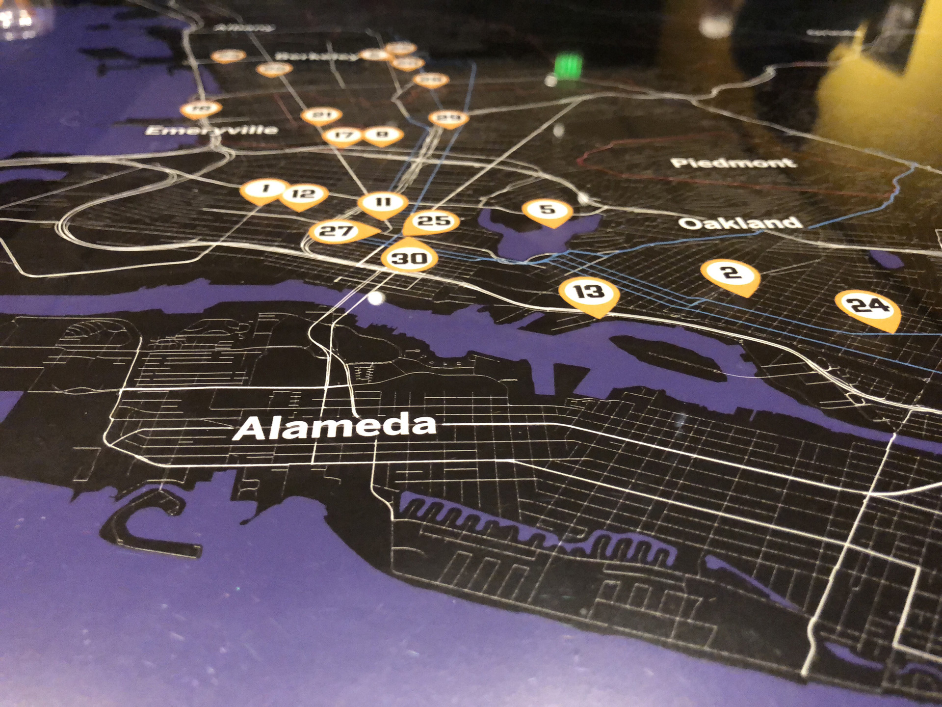 A map at the exhibit pinpoints parts of the Bay Area of important hip-hop landmarks and history.