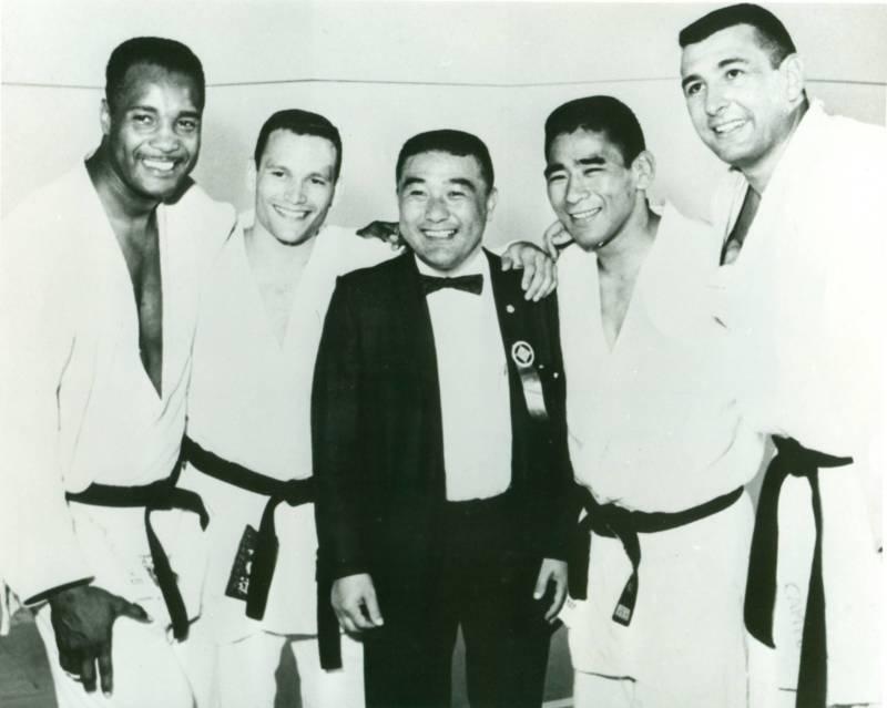 Yoshihiro Uchida at the 1964 Tokyo Olympics with George Lee Harris, Jim Bregman, Paul Maruyama and Ben Nighthorse Campbell.