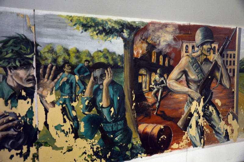 Some of Gerber's murals, like this one, showed vivid scenes of military combat, while others showed more relaxing aspects of military life.