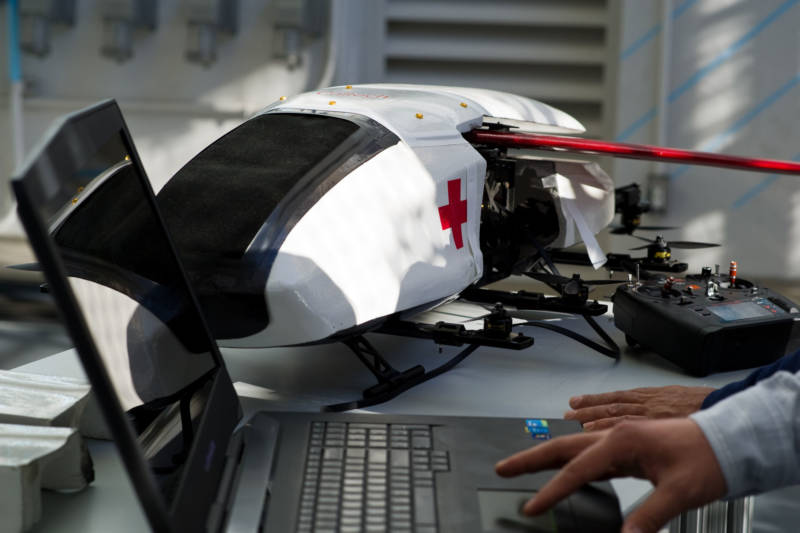 The scale-model ambulance robot sits on a desk at Caltech's CAST lab.