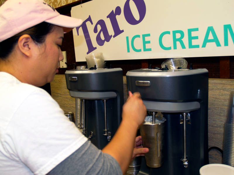 A Fosselman's manager makes a shake, below a sign advertising Taro ice cream.