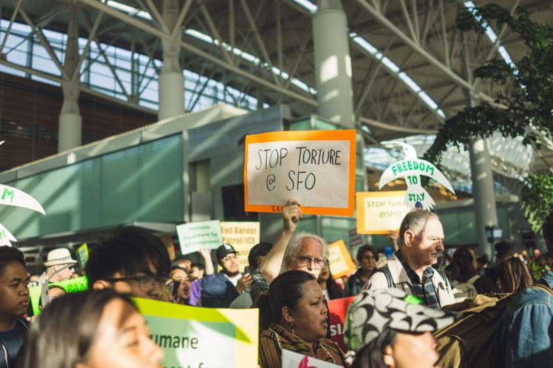 Jerome Aba's supporters protest at SFO on April 17, 2018.