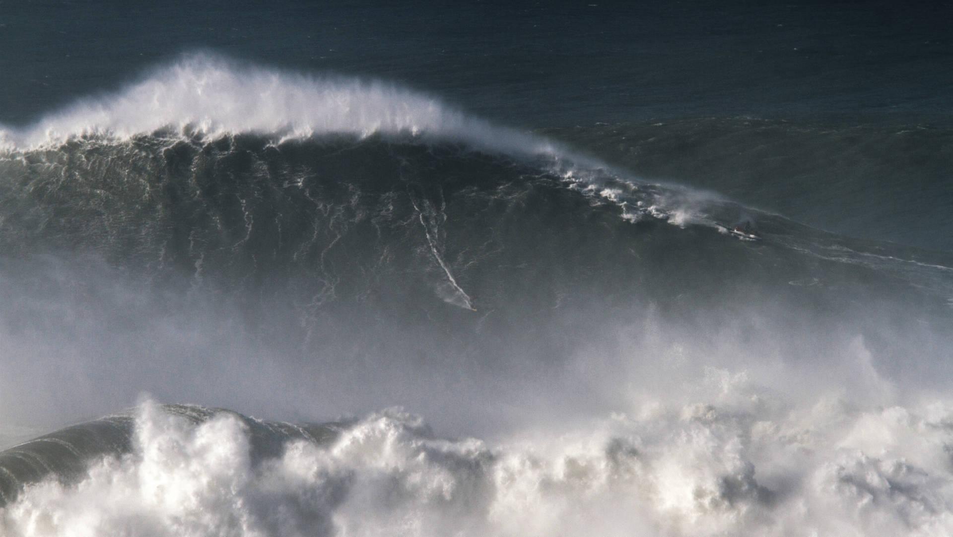 Trust us: Brazilian surfer Rodrigo Koxa is somewhere in this shot of his 80-foot ride last November in Nazaré, Portugal. Pedro Cruz/AP