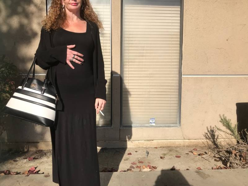 Amanda, pregnant, standing outside a methadone clinic in Fresno.