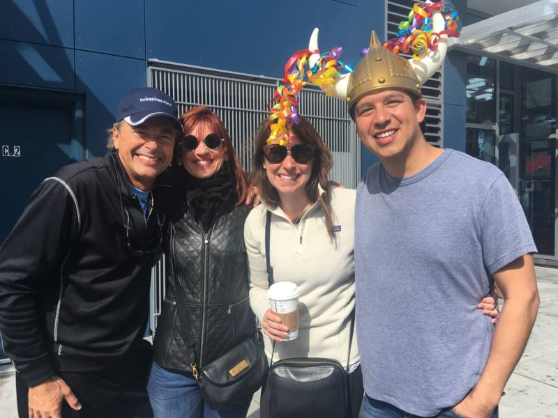 San Francisco residents Seth and Sarah Hernandez (right) bring along visiting relatives Lori and Mike Solomon to witness the festivities. Race organizers say approximately 150,000 spectators lined the route on Sunday.
