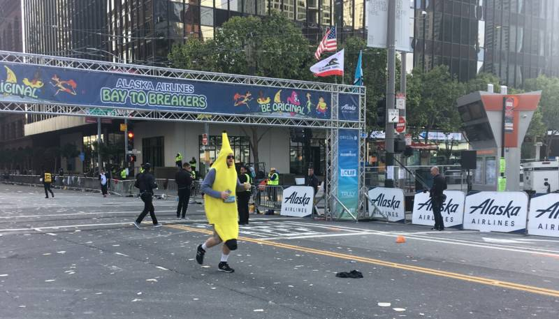 A lone racer, dressed as a banana, is seen at the Bay to Breakers starting line.
