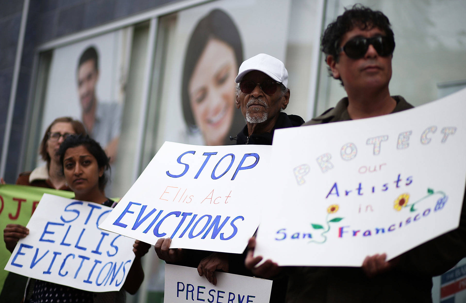 Activists and tenants of 1049 Market Street hold signs as they stage a protest against the landlord's attempts to evict them from the building on March 8, 2016 in San Francisco. Justin Sullivan/Getty Images