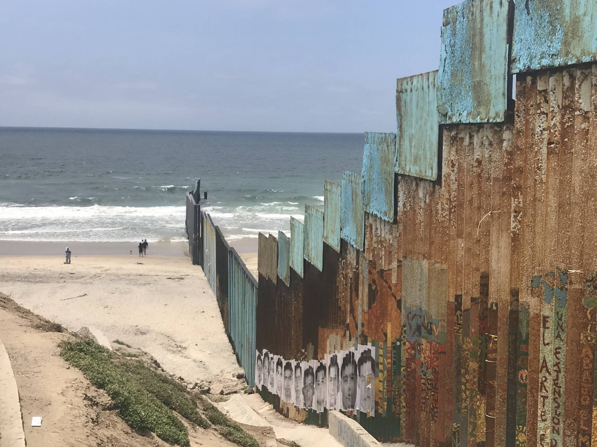The Friendship Park wall runs into the Pacific. KQED/Polly Stryker.