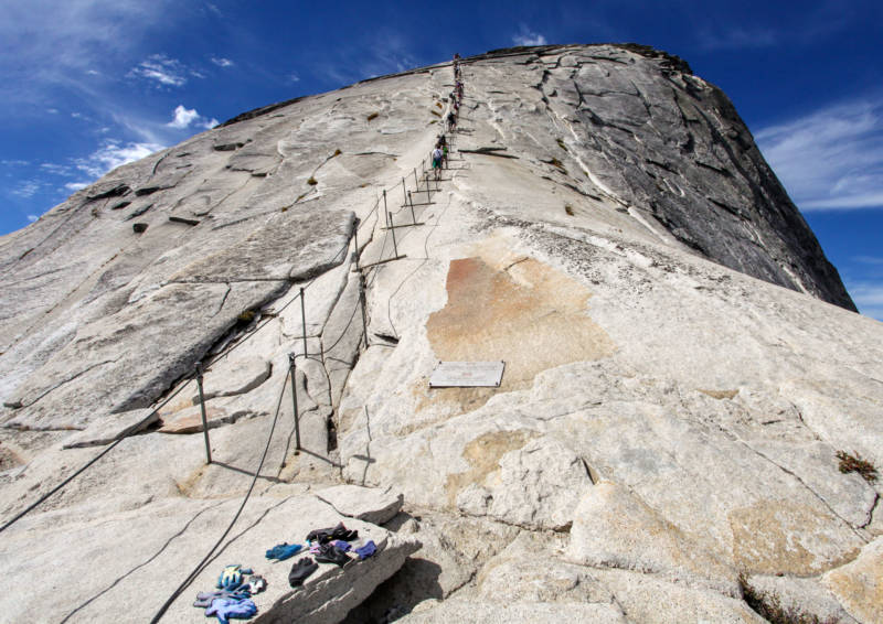 The infamous section of the Half Dome trail lined by support cables, pictured in good weather in 2012.