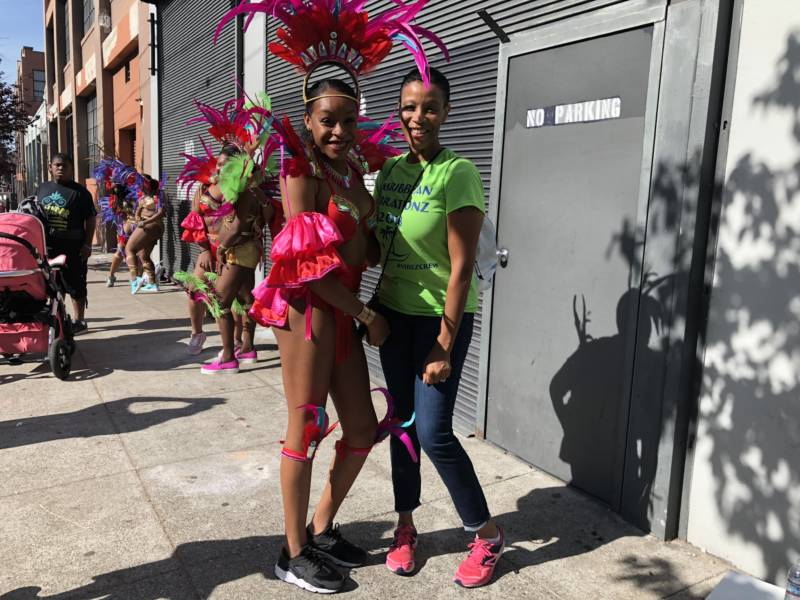 'I feel pretty pumped,' said Symone Watson (L), preparing for her first Carnaval parade with the dance group Caribbean Vibrationz.