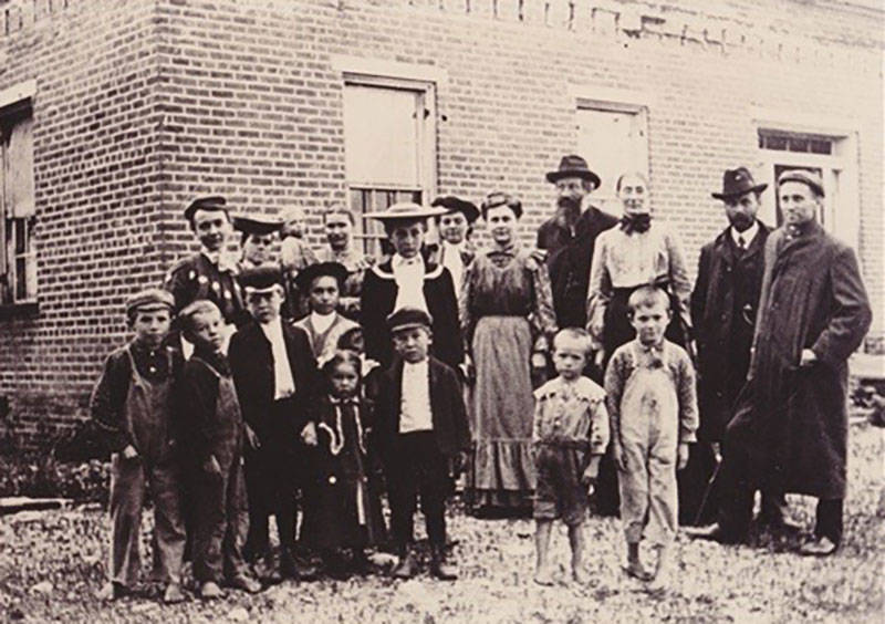 Members of the Nazarene Church stand in front of the John Rains House in Rancho Cucamonga, 1902.