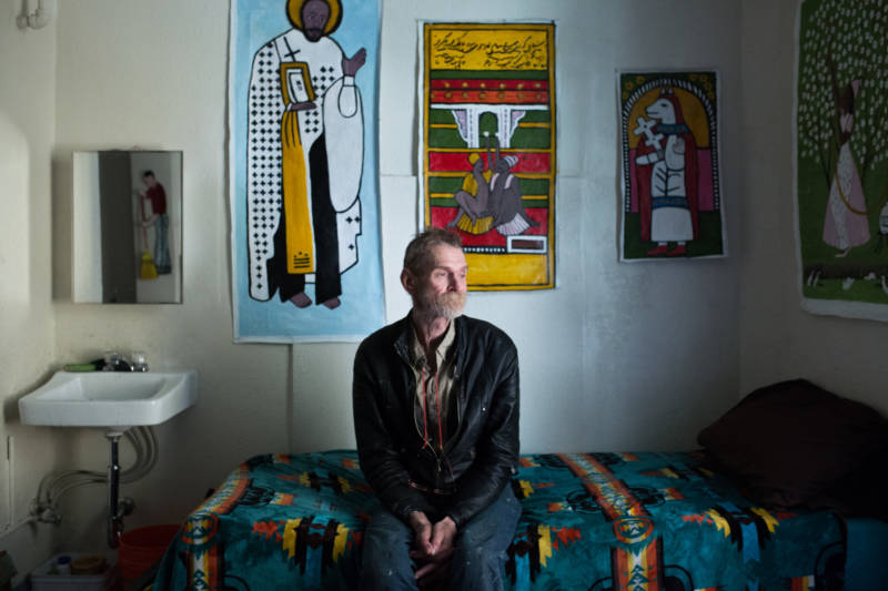 Jeff Marshal sits in his single-room occupancy hotel room, or SRO, in the Tenderloin. The neighborhood has the most SROs in the city, which have helped stave off gentrification.