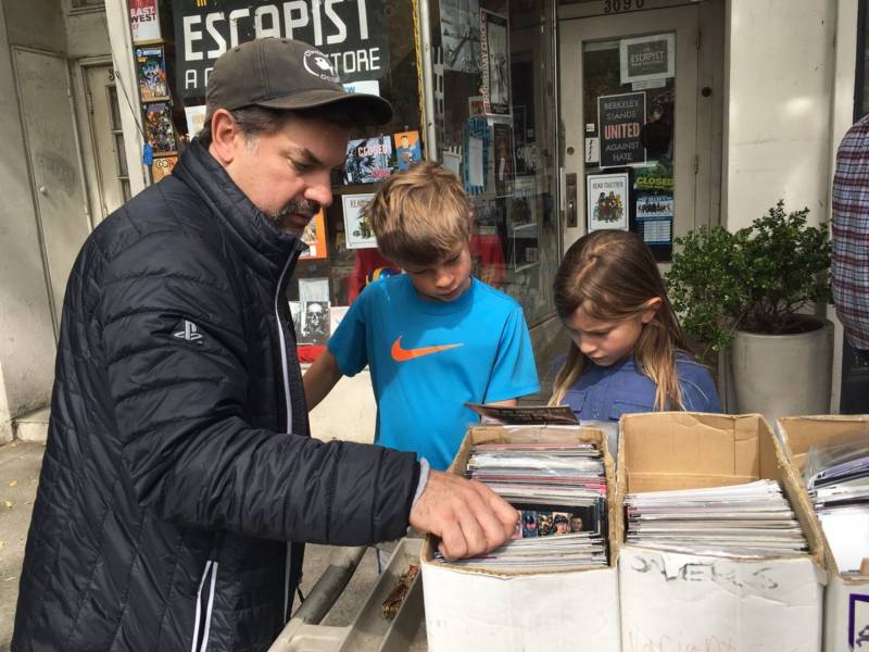 Mike Mika and his kids Ellis and Emerson, from Berkeley, look for Avengers comics at the Escapist Comic Bookstore in Berkeley on Saturday, May 5, 2018.