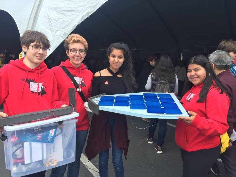 "The Berkeley High School Robotics Team shows off part of their solar-powered racing robot. ""It's basically like a three wheel designed to get aerodynamic so it can go very quickly in the race field and beat the other robots,"" said team member Cecilia Estrada."