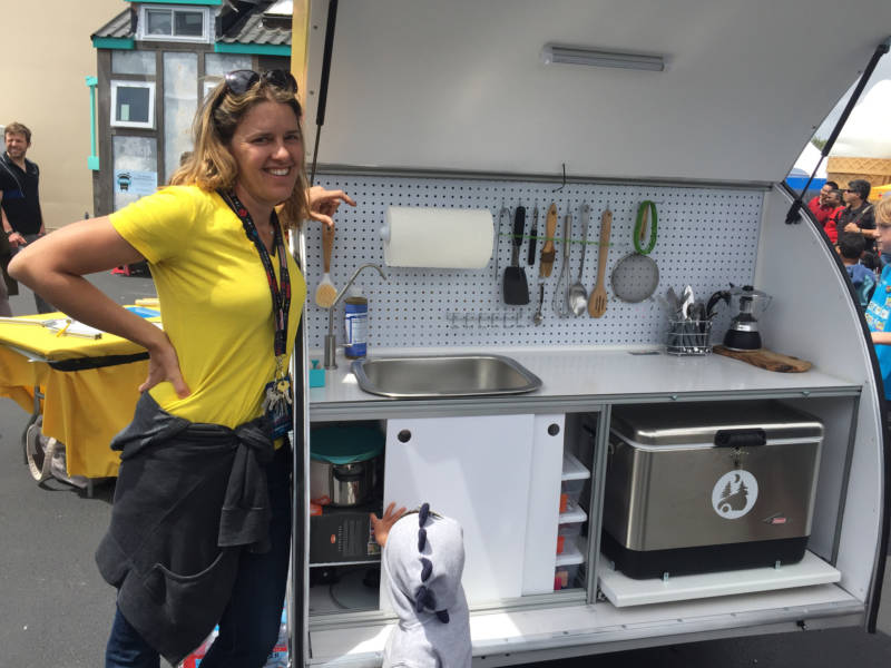 Jaime Goodrich, head tinkerer of Tinkerdrop, stands beside the back of her DIY trailer, complete with a full kitchen. She was selling kits that would allow anyone to make their own live-in trailer.