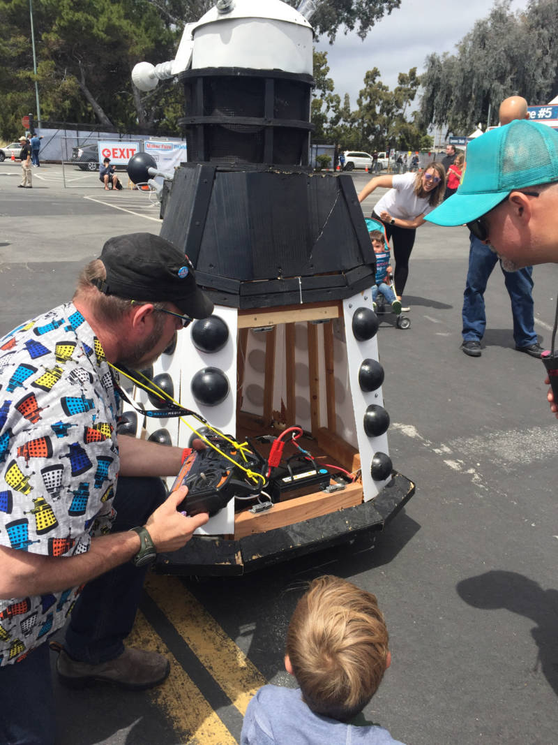 One of the makers shows 6-year-old Aiden Runquist of Santa Rosa his Dalek, a monster character from the television series 'Doctor Who.' The Dalek made noises at lit up leading Runquist to ask, 'Oh so when it gets mad it does that?'
