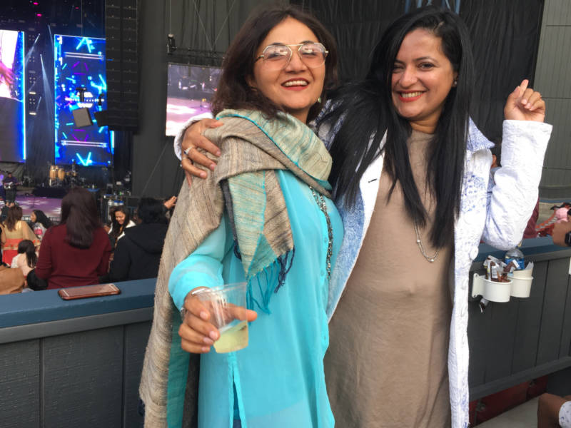 Sarhya Laranth and Meenalshi of Palo Alto dance along to Bollywood star Benny Dayal at the Gaana Music Festival in Mountain View. They were most excited to see musician Arijit Singh, who also preformed.