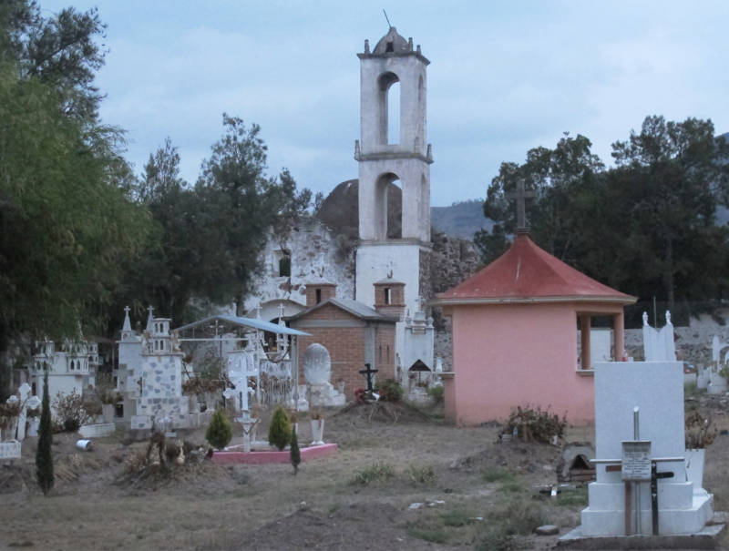 A church rises behind the cemetery in Santa Monica, Hidalgo.
