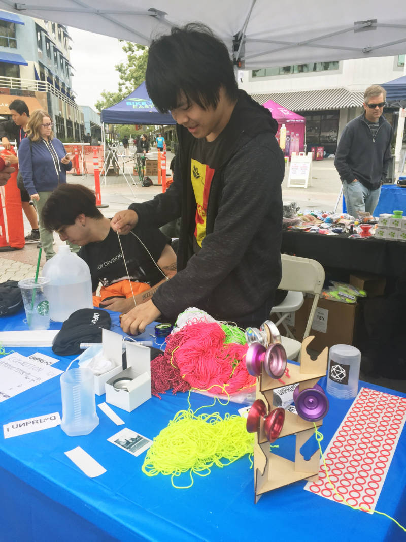 Tyler Hsieh, 23, works a vendor booth at the Bay Area Classic. He has his own line of yo-yos called UNPRLD. He said he didn't like the models that were available when he started yo-yo-ing 10 years ago, so he started his own brand.