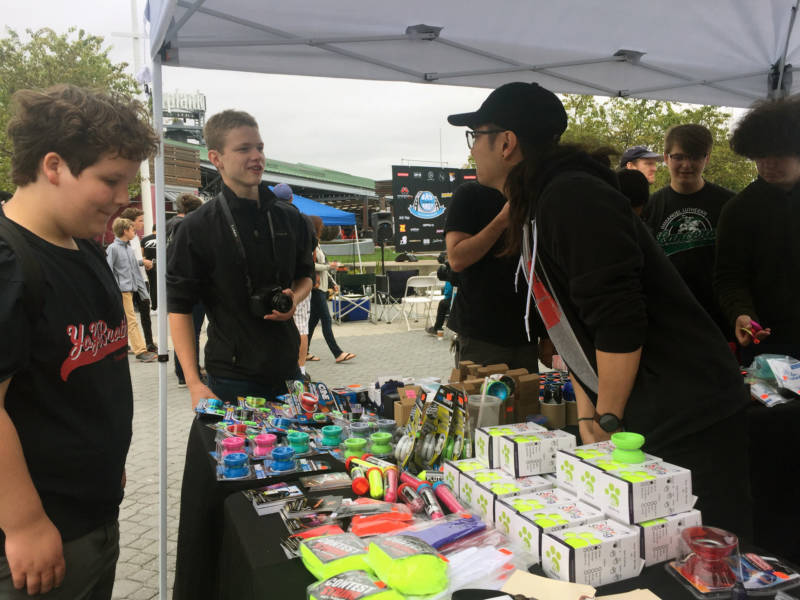A vendor talks with a couple of yo-yo fans at the Bay Area Classic. Some of those in attendance came to get inspiration from the competitors in hopes of qualifying for the event next year.