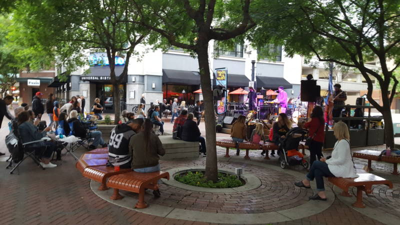 People gather for a public concert in Modesto's 10th Street Plaza.