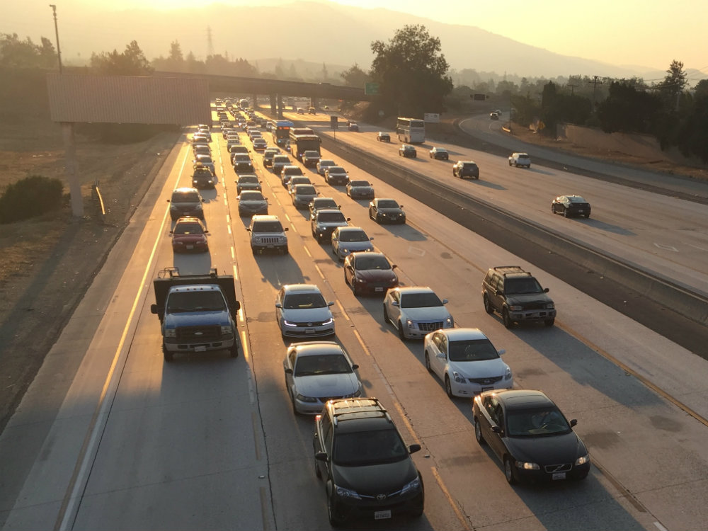 On Oct. 13, 2017, during the North Bay fires, cars slow during rush hour traffic on Highway 280 in Cupertino. Haze from the fires is visible in the air.  Isha Salian/Peninsula Press