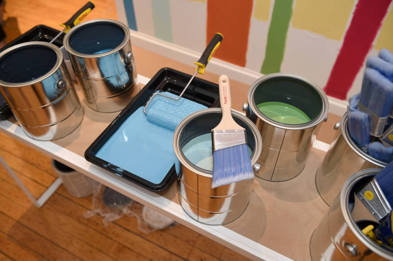 Sherwin Williams paint cans at a promotional event in 2015. Sherwin Williams is one of three paint companies working to overturn a ruling that says they must pay to clean up lead paint in older homes across California.