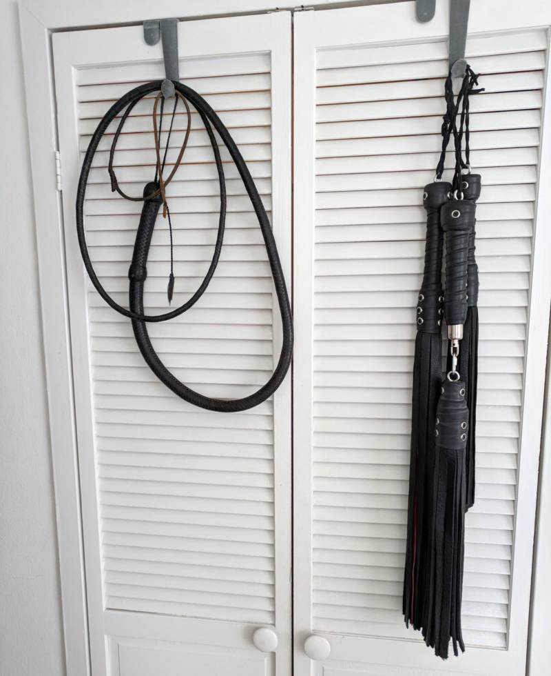 Grace's whip and collection of floggers. They range from supple deer skin to brutally tough bull hide.