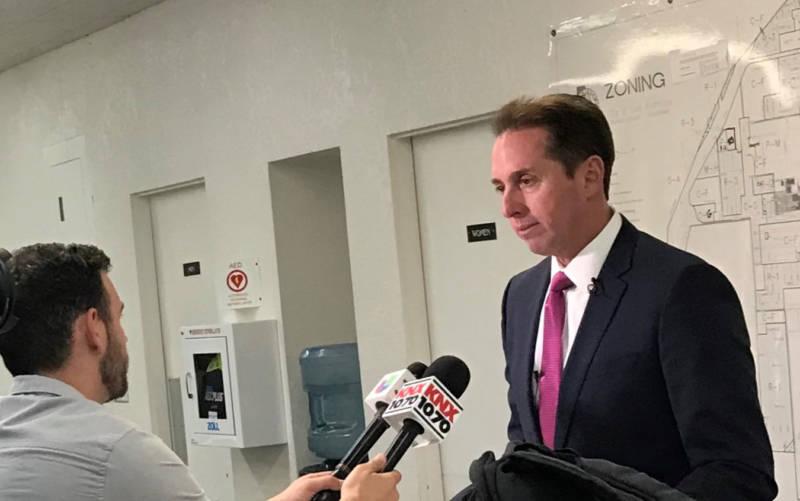 Los Alamitos Mayor Troy Edgar talks to reporters.