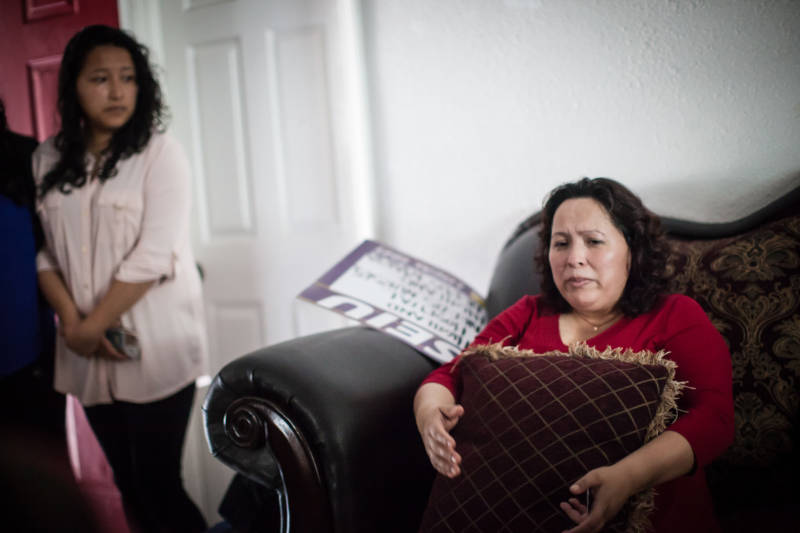 Maria Mendoza-Sanchez sits on a couch in her Oakland home on Aug. 16, 2017, hours before she, her husband and son leave Oakland for Mexico City. Her daughter, Melin Sanchez, 21, cries as she watches her mother with concern.
