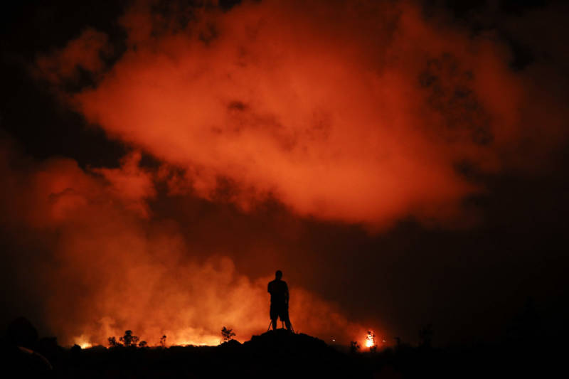 Peter Vance, 24, photographs lava erupting in Leilani Estates on Friday.