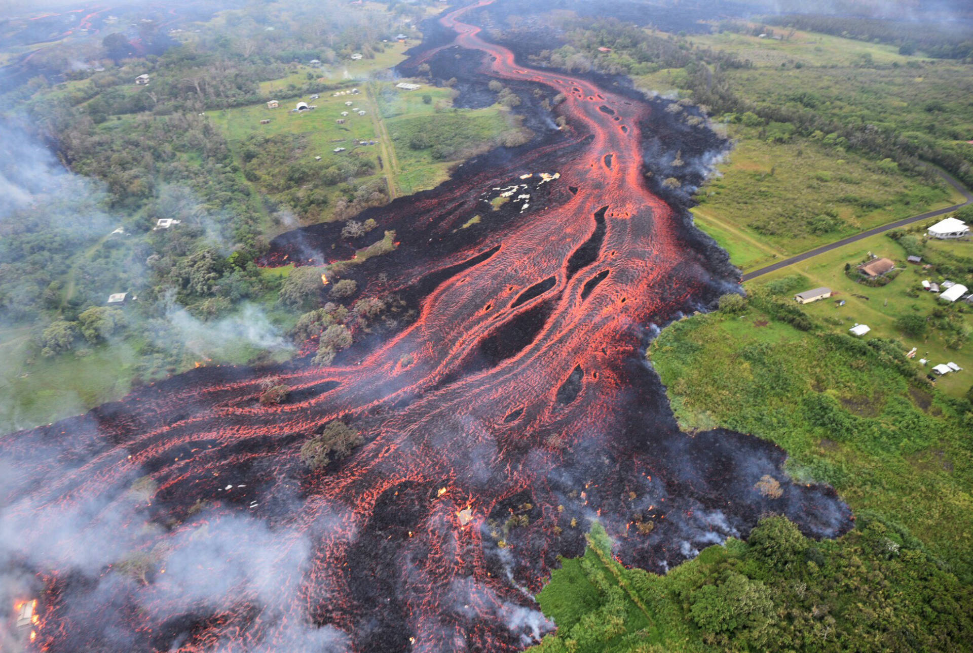 Lava flows from fissures near Pahoa, Hawaii, on Saturday. USGS/AP